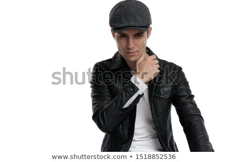 man in studio sitting and touching his neck  Stock photo © feedough