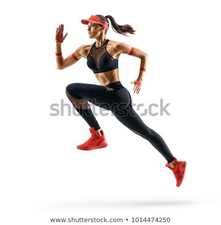 Skoki dziewczyna odzież sportowa biały studio Zdjęcia stock © bezikus