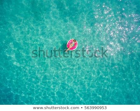 vrolijk · dame · ontspannen · hotels · zwemmen · zwembad - stockfoto © konradbak