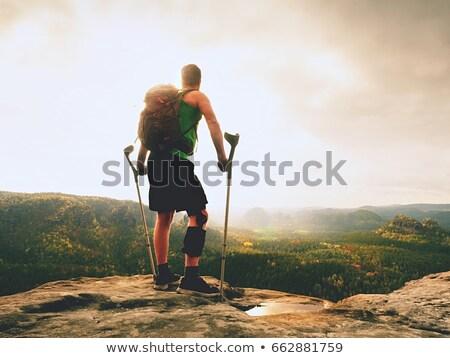 Injured traveler with broken arm. Stock photo © RAStudio
