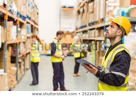 Warehouse manager writing on clipboard Stock photo © wavebreak_media