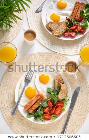Uova salsiccia bianco piatto Foto d'archivio © Digifoodstock
