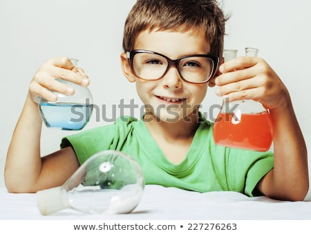 little cute boy with medicine glass isolated stock photo © iordani