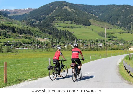 Couple cycling through trees Stock photo © IS2