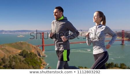 happy couple running over golden gate bridge Stock photo © dolgachov