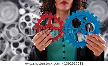 Femme d'affaires connecter engins pièces travail d'équipe association Photo stock © alphaspirit