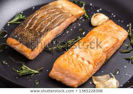 Baked salmon in frying pan Stock photo © YuliyaGontar