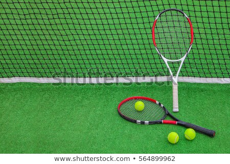 Two tennis rackets and three yellow balls Stock photo © pressmaster