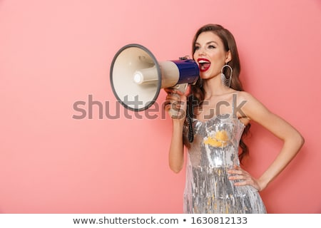 Woman in bright sequins dress holding loudspeaker. Stock photo © deandrobot