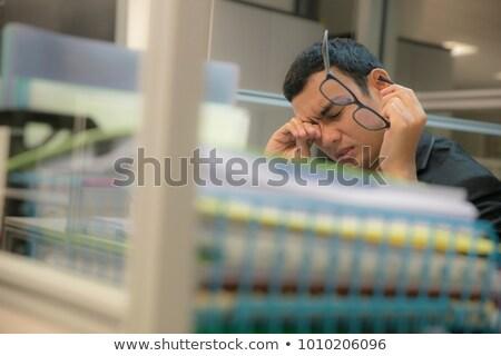 irodai · dolgozó · elégedetlen · fáradt · néz · üzlet · iskola - stock fotó © photography33