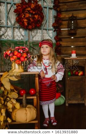 Beautiful girl in ukrainian embroidered shirt Stock photo © Len44ik