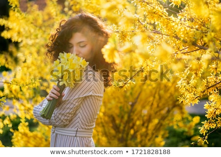 beautiful smiling woman and pink magnolia Stock photo © juniart