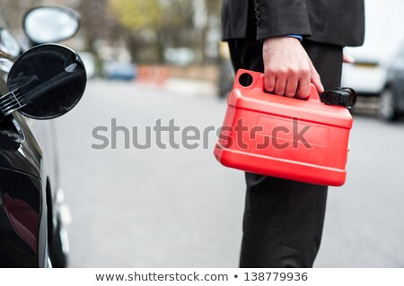 Man holding fuel can, cropped image Stock photo © stockyimages