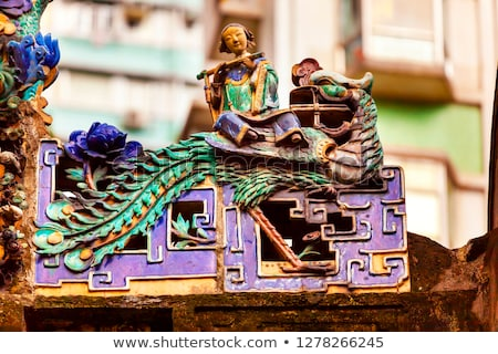 Porcelain Roof Chinese Figurines, Flutist,  Man Mo Temple  Hong  Stock photo © billperry