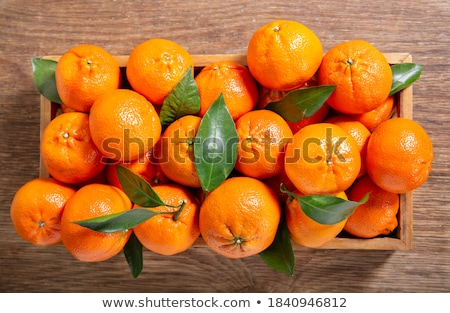 wooden box with mandarines Stock photo © compuinfoto