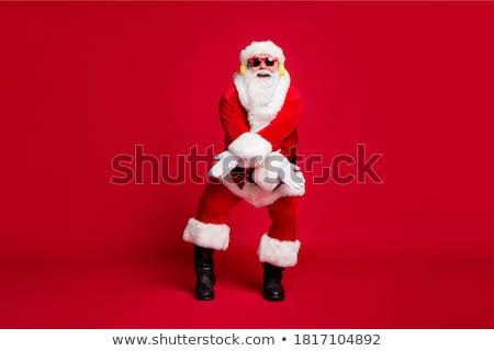 santa claus is listening music stock photo © hasloo