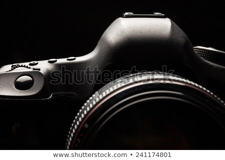 Professional modern DSLR camera low key image  Stock photo © lightpoet