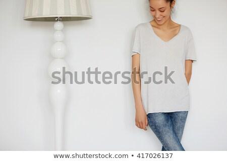 Jeune fille shirt grand isolé Photo stock © tamasvargyasi