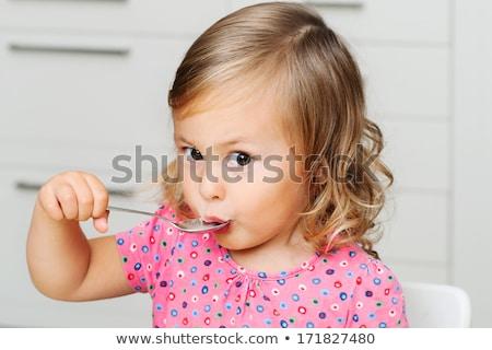 gyönyörű · kislány · könyvtár · könyv · könyvek · gyerekek - stock fotó © velkol