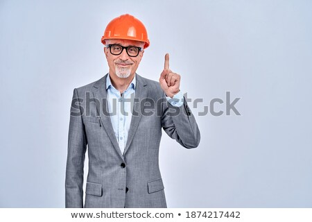 mature engineer in suit wearing glasses and helmet stock photo © feedough
