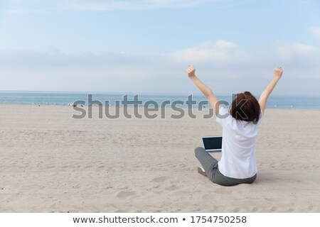 woman enjoying her vacation on an empty beach stock photo © kzenon