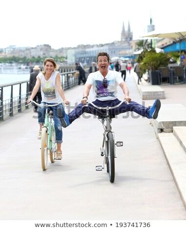 женщину велосипедов конец док озеро велосипед Сток-фото © IS2