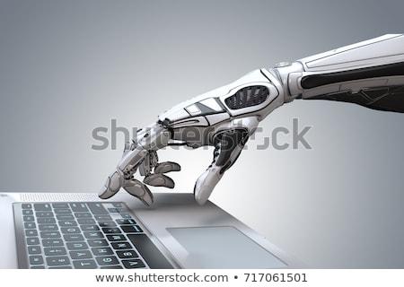 Robotic Hand Working On Laptop Stock photo © AndreyPopov