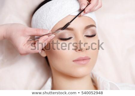 женщину бровь лечение салон красоты счастливым красоту Сток-фото © Kzenon