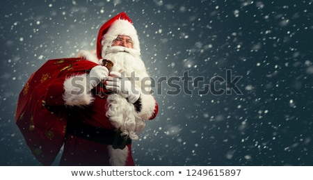 portrait of old santa holding bag and ringing bell Stock photo © feedough