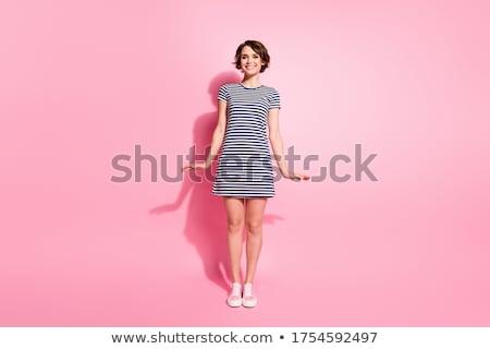 довольно девушки розовый короткий платье изолированный Сток-фото © Elnur