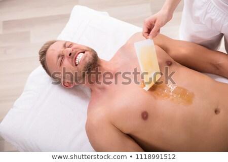 Homem gritando depilação com cera peito moço Foto stock © AndreyPopov