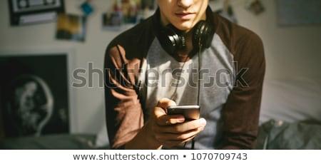 słuchać · muzyki · widok · z · tyłu · młody · człowiek · słuchania · słuchawki - zdjęcia stock © boggy