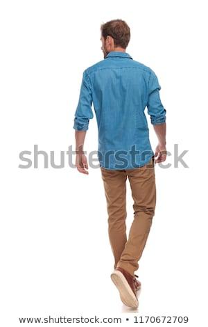 Widok z boku szczęśliwy młody człowiek spaceru naprzód biały Zdjęcia stock © feedough