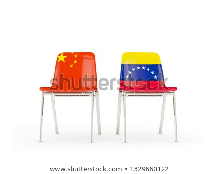 Two chairs with flags of China and venezuela Stock photo © MikhailMishchenko