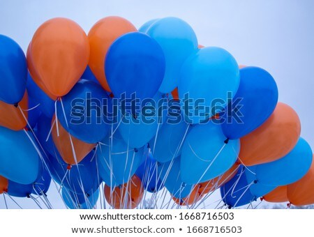 close up of colorful helium balloons in blue sky Stock photo © dolgachov