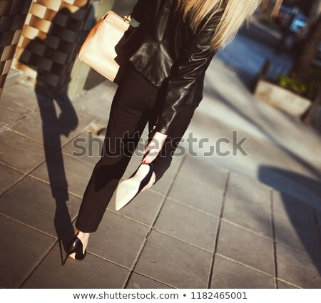 girl in a black leather jacket walks through the city stock photo © ruslanshramko