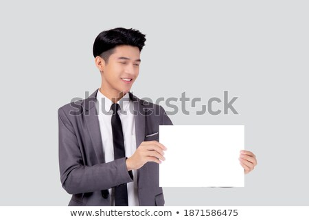 Cheerful businessman presenting white empty card. Stock photo © lichtmeister