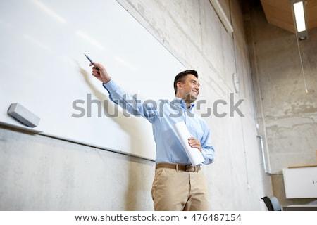 Nauczyciel wskazując znacznik wykład edukacji Zdjęcia stock © dolgachov
