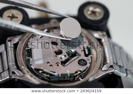 Tweezers With Battery And Wrist Watch Stock photo © AndreyPopov