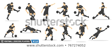 Soccer football player dribbling a ball and kick a ball Stock photo © matimix