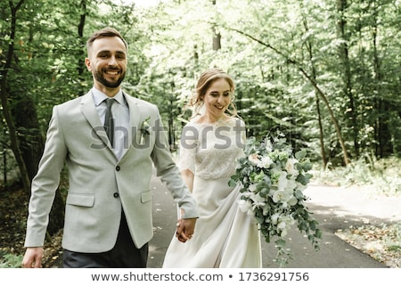 People, relationship and marriage concept. Just married bride and bridegroom kiss passionately, expr Stock photo © vkstudio