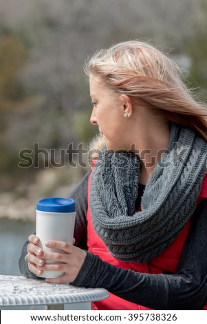 Casual young blonde woman at home in grey vest stock photo © darrinhenry