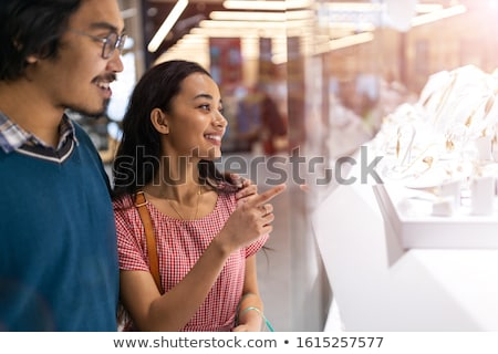 portrait of young couple embracing at shopping mall and looking stock photo © hasloo