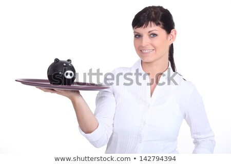 Woman holding tray with piggy bank on it stock photo © photography33