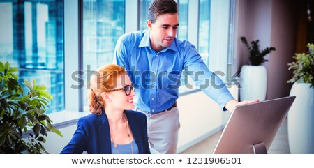Man in spectacles showing on window plant Stock photo © pzaxe