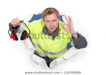 Tradesman promoting the use of earmuffs Stock photo © photography33