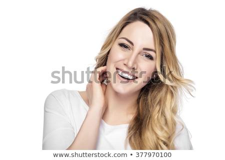 gyönyörű · fiatal · szőke · mosolyog · fiatal · nő · fekszik - stock fotó © courtyardpix