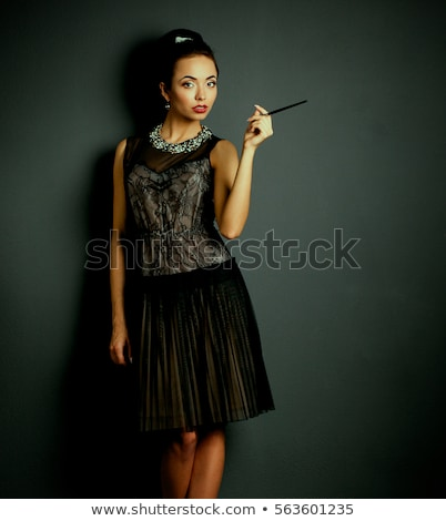 young brunette with a mouthpiece in hand Stock photo © acidgrey