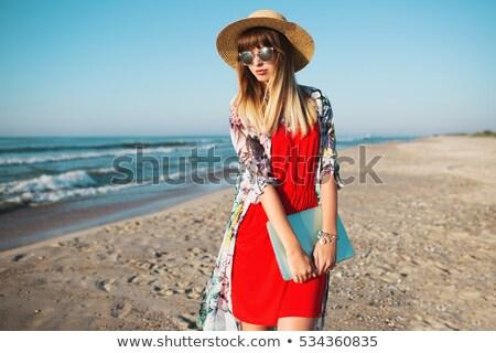 Kadın güneş gözlüğü kırmızı elbise seksi Stok fotoğraf © wavebreak_media
