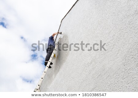 man reaching down with a paintbrush stock photo © photography33
